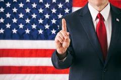 Polityk: Mężczyzna Z palcem W liczby Jeden pozyci obraz royalty free