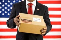Polityk: Trzymać karton Wysyłać Zdjęcie Royalty Free