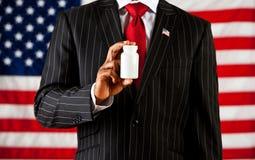Polityk: Trzymać Pustą medycyny butelkę obrazy stock