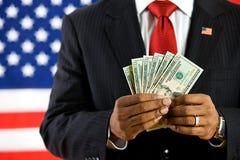 Polityk: Trzymać fan USA waluta Fotografia Royalty Free