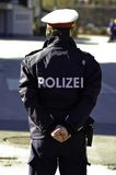 Polizei. The back of a policeman in Austria Stock Images