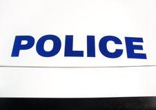 Polizei auf Autohaube Stockfotografie