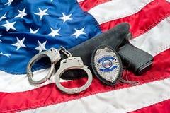 Polizei badge und schießt Lizenzfreies Stockfoto