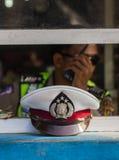 Polizei bedeckt mit einer Kappe Lizenzfreie Stockfotos
