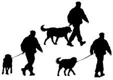 Polizei bemannt mit einem Hund Stockfoto