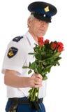 Polizei bemannt mit Rosen Lizenzfreies Stockfoto
