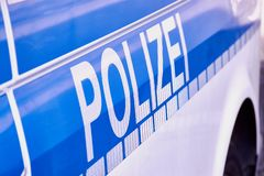 German word Polizei on a German police car stock images