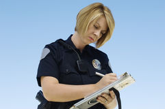 Polizeibeamte Writing Ticket Lizenzfreies Stockbild