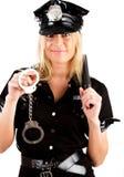 Polizeibeamtin, die einen Steuerknüppel anhält Lizenzfreie Stockbilder