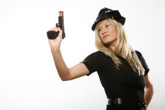Polizeibeamtinspindel mit Gewehr Stockfotos