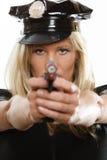 Polizeibeamtinspindel mit Gewehr Stockfotografie