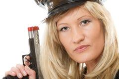 Polizeibeamtinspindel mit Gewehr Stockbilder