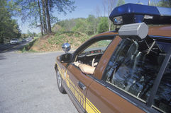 Polizeichef, der im Auto sitzt Stockbilder