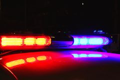 Polizeilichter bis zum Nacht Stockfotografie