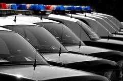 Polizeiwagen in einer Reihe Lizenzfreies Stockfoto