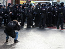 Polizia avveduta del fotografo di azione Immagini Stock