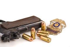 Polizia del distintivo dei richiami della pistola immagine stock