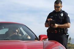 Poliziotto di traffico in automobile sportiva Fotografie Stock