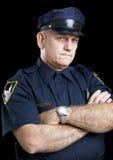 Poliziotto sul nero - braccia piegate Immagine Stock