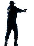 Polizist, der Pistole zielt lizenzfreie stockfotografie