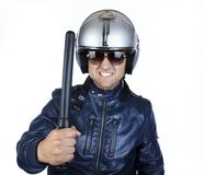 Polizist hält einen Steuerknüppel an Lizenzfreies Stockfoto