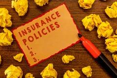 Polizze d'assicurazione di scrittura del testo della scrittura Il significato di concetto ha documentato il risarcimento finanzia immagini stock