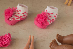 polka dot baby socks and legs of dolls Stock Images
