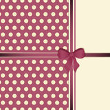 Polka dot background with bow Royalty Free Stock Photography
