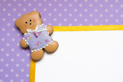 Polka-dot background with a honey-cake bear Stock Images