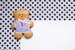Polka-dot background with  a honey-cake bear Royalty Free Stock Photos