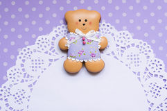 Polka-dot background with a honey-cake bear and a napkin Stock Image