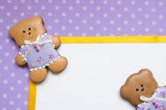 Polka-dot background with  honey-cake bears Stock Photo