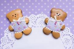 Polka-dot background with honey-cake bears and a napkin Royalty Free Stock Photos