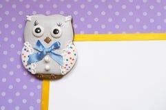 Polka-dot background with  a honey-cake owl Stock Image