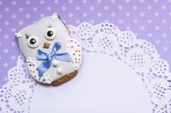 Polka-dot background with a honey-cake owl and a napkin Stock Photos