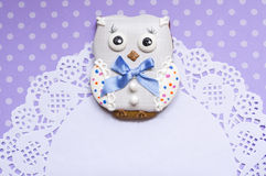 Polka-dot background with a honey-cake owl and a napkin Stock Images