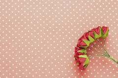Polka dot background. Red decorative flowers. Close-up. Place for text.  royalty free stock photography