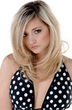 Polka dot Blonde. Close-up of a beautiful young blonde haired, blue eyed fashion model in a black and white polka dot bikini Royalty Free Stock Photography