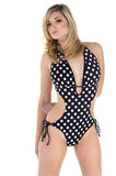 Polka dot Blonde. Beautiful young blonde haired, blue eyed fashion model in a black and white polka dot bikini Royalty Free Stock Images