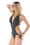 Polka dot Blonde. Beautiful young blonde haired, blue eyed fashion model wearing a black and white polka dot monokini Royalty Free Stock Image