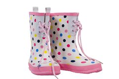 Polka Dot Boots. Polka dot rain boots  with pink trim isolated on a white background with clipping path Royalty Free Stock Images