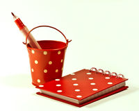 Polka dot bucket and notebook Stock Image