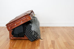 Polka dot clothing in a retro suitcase Royalty Free Stock Photo