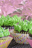 Polka dot cupcakes. Delicious cupcakes with green frosting and sprinkles Stock Images
