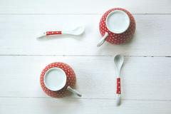 Polka dot cups and spoons Royalty Free Stock Photos