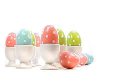 Polka dot easter eggs in cups on white Stock Image