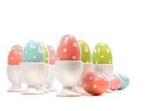 Polka dot easter eggs in cups on white Stock Image
