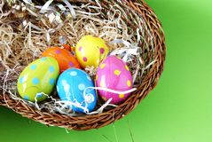Polka dot Easter eggs lying in straw Royalty Free Stock Images