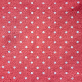 Polka-dot fabric. Polka dot pink retro fabric background Stock Photos