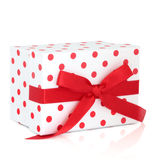 Polka Dot Gift Box. Red and white polka dot gift box with ribbon and bow, isolated over white background Royalty Free Stock Photo